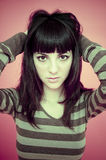 Girl in striped sweater royalty free stock image