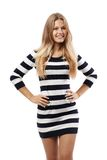 Girl in a striped sweater hands on your hips Royalty Free Stock Images
