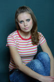 Girl in a striped T-shirt. Beautiful young girl in a striped T-shirt Royalty Free Stock Images