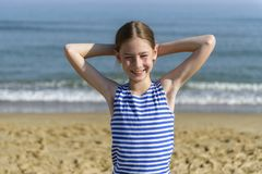 Girl in striped t-shirt looking at the sea royalty free stock image