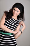 Girl in a striped tunic. Studio portrait of a girl in a striped tunic Royalty Free Stock Photo