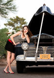 Girl in stripes with vintage car Royalty Free Stock Image