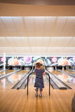Girl (3) in stripey dress at bowling alley Stock Images