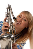 Girl in a stripped vest with a saxophone Stock Photo