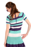 Girl in stripy blue dress posing. Stock Photography
