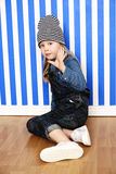 Girl in stripy hat posing Royalty Free Stock Photography