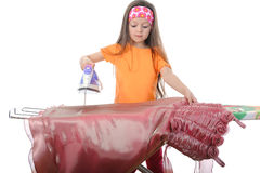 Girl stroking a pink evening dress iron. Isolated on white background Royalty Free Stock Photos