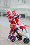 Girl with  stroller Stock Photo