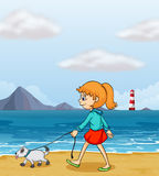 A girl strolling at the beach with a puppy Stock Images