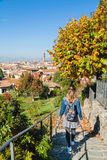 Girl strolling through the rose garden in autumn Florence, Tuscany, Italy. Royalty Free Stock Photography