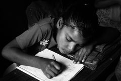 A girl student. An Indian girl is writing on her copy in a primary school in India Royalty Free Stock Image