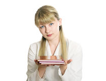 Girl student. Holding books in his outstretched hands Stock Photography