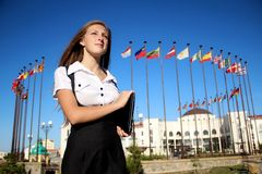 Girl student on the background of international Royalty Free Stock Photography