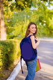 A girl student with a backpack in  park Royalty Free Stock Image