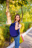 A girl student with a backpack in  park Stock Image
