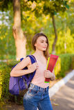A girl student with a backpack in  park Stock Photo