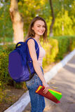 A girl student with a backpack in  park Royalty Free Stock Photography