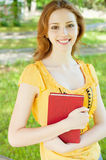 Girl-student with a book Stock Images