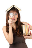 Girl student with books and magnifying glass Stock Photo