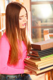 Girl student in college library Royalty Free Stock Photos