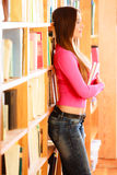 Girl student in college library Royalty Free Stock Image