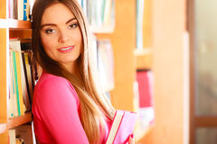 Girl student in college library Stock Photo