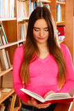 Girl student in college library Royalty Free Stock Photo