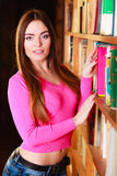 Girl student in college library Stock Photos
