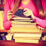 Girl student in college library. Education school concept. Closeup female student girl in college library with stack books pen Royalty Free Stock Photos