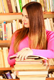 Girl student in college library. Education school concept. Intelligent female student fashion long hair girl in college library with pen Stock Photos