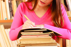 Girl student in college library Stock Photography