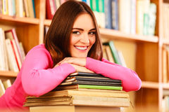 Girl student in college library. Education school concept. Smiling female student fashion long hair girl in college library Royalty Free Stock Images