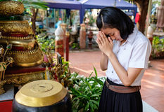 Girl student donate money for temple. Young thai girl student in uniform donate money for buddhism temple in Thailand Royalty Free Stock Photos