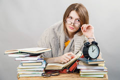 Girl student with glasses reading books. Funny crazy  girl student with glasses reading books Royalty Free Stock Photo