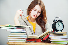 Girl student with glasses reading books Royalty Free Stock Image