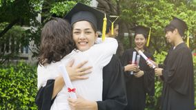Girl student with the Graduation gowns and hat hug the parent in royalty free stock images