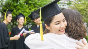 Girl student with the Graduation gowns and hat hug the parent in. Congratulation ceremony royalty free stock photo