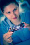 girl student with a hard disk HDD in hands Stock Image