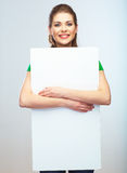 Girl student hold white blank board. White background young wom Royalty Free Stock Photography