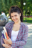 Girl student holding a book in her hands. Stock Photos