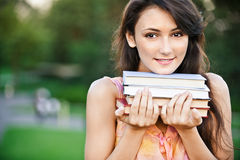Girl-student holds textbooks Stock Photography