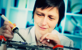 Laboratory of electronics. Girl student in the laboratory of electronics university Stock Photo