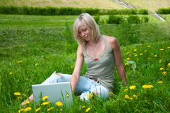 A girl student with a laptop Stock Photography