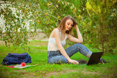 Girl student with a laptop and a backpack Stock Photos
