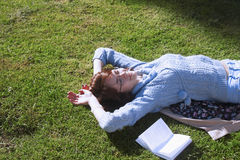 Girl student learning on the grass in the park education, self- Royalty Free Stock Image