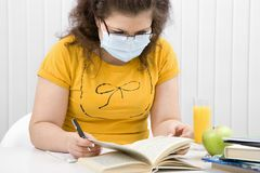 Girl student in a medical mask Stock Photos