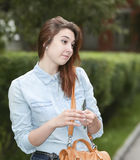 Girl student in the Park after school. Royalty Free Stock Photos
