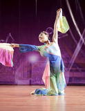 Girl student perform folding fan dance Royalty Free Stock Images