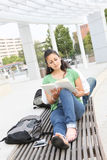 Girl Student Reading on the School Campus Royalty Free Stock Photography