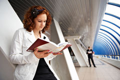 Girl student reading a textbook Stock Image